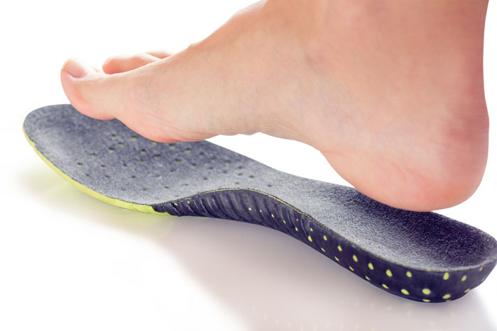 Custom insoles fit to correct foot function.