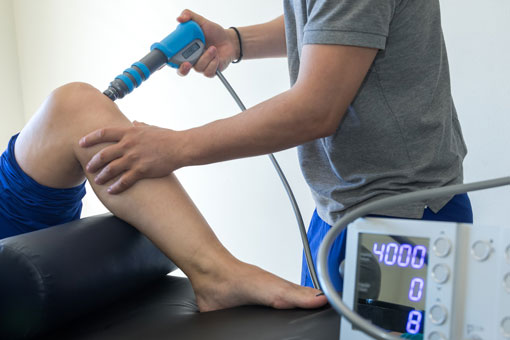Physical therapy of the knee and the foot using shock wave therapy.